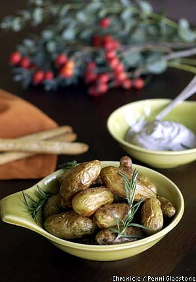Roasted potatoes with fresh rosemary to dip in mayonnaise and black olive paste with chopped garlic. Chronicle photo by Penni Gladstone