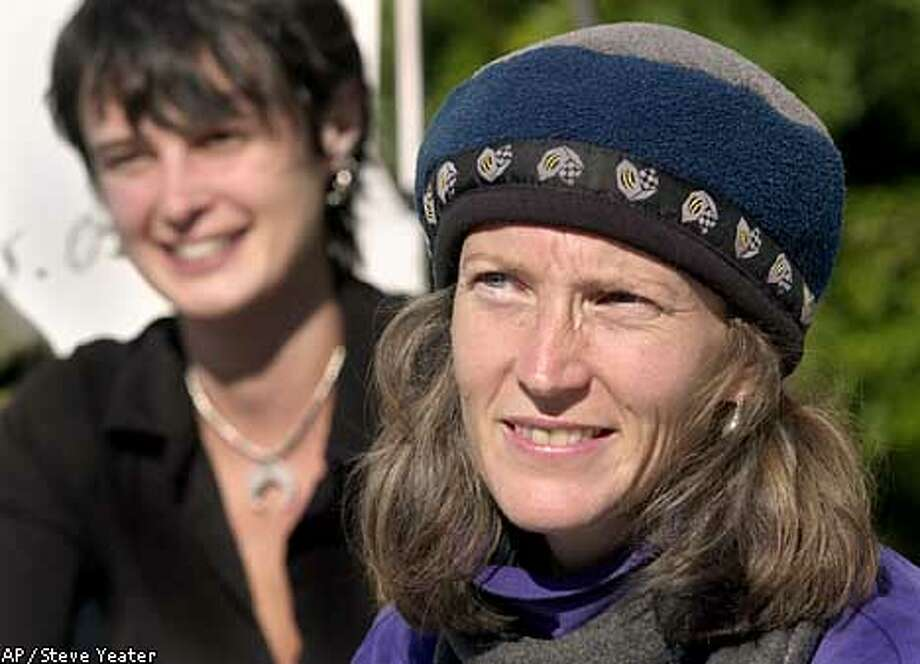 "Environmental activist Susan Moloney, right, talks to reporters at a news conference on the 50th day of her hunger strike to save California's at the Capitol in Sacramento, Calif., Monday, Nov. 25, 2002. Moloney was joined by Julia ""Butterfly"" Hill, left, who pledged not to eat until some sort of response from Gov. Davis concerning the fate of the trees. (AP Photo/Steve Yeater) Photo: STEVE YEATER"