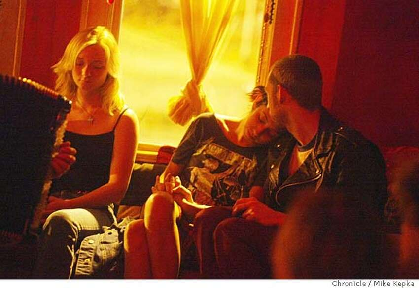 Elise Mahan, Marissa Mock and Jesse Hix listen to a moveing piece performed by musician, Mark Growden. Epic Arts in Berekely is a community arts venue, converted from an old house, which is open to people intersted in experiencing and perfoming art through music and other ways. 6/3/04 in Berkeley. Mike Kepka / The Chronicle