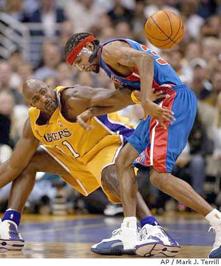 Los Angeles Lakers' Karl Malone (11) strips Detroit Pistons' Richard Hamilton of the ball during the second quarter of Game 2 of the , Tuesday, June 8, 2004, in Los Angeles. (AP Photo/Mark J. Terrill) Photo: MARK J. TERRILL
