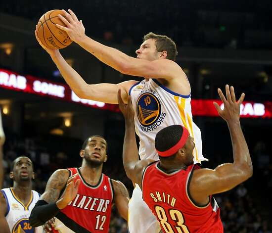 Golden State Warriors' Davis Lee (10) shoots between Portland Trail Blazers Lamarcus Aldridge (12) and Craig Smith (83) during the second half of their NBA basketball game in Oakland, Calif., Wednesday, January 25, 2012. Photo: Lance Iversen, The Chronicle