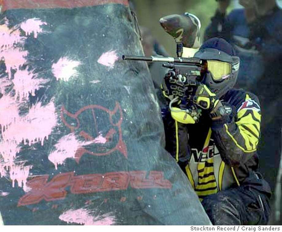 Fire.Games.832 -- Record Photo by CRAIG SANDERS Police and Fire games in Stockton. The paintball games are being held on Rough and Ready Island, pictured is Mike Miller from Team Baffle formed of San Francisco Sheriff's deputies They were playing a team from the Central California Women's Facility in Chowchilla. Photo: CRAIG SANDERS