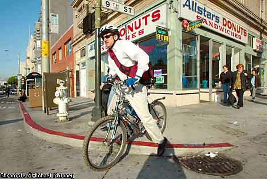 KLAUSNER1-C-23AUG02-MT-MJM Dr. Jeffrey Klausner commutes to work by bike most days of the week. Here he is on his way from his office on Mission Street to one of the south of Market health clinics. Newsmaker profile on Dr. Jeffrey Klausner, San Francisco's director of sexually transmitted disease prevention. CHRONICLE PHOTO BY MICHAEL MALONEY