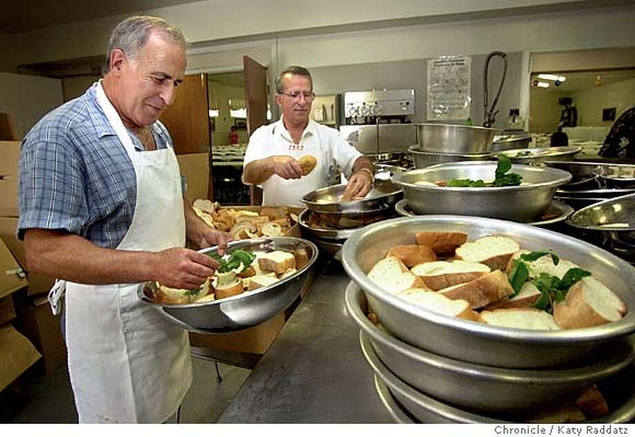 SHOWN: The men do the cooking! In the community center kitchen, we find: L to R: Albano Cardosa and Antonio Jorge prepare bowls of bread and mint. The 9,000 lbs. for pot roast and gravy will put put on top of the bread, them served. Portugal Day Festival in Union City, California; it's a Holy Spirit Festival. Katy Raddatz / The Chronicle Photo: Katy Raddatz