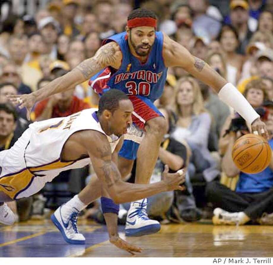 Los Angeles Lakers' Kobe Bryant dives for a loose ball against Detroit Pistons' Rasheed Wallace (30) during the fourth quarter of Game 1 of the NBA Finals, Sunday, June 6, 2004, in Los Angeles. The Pistons won, 87-75. (AP Photo/Mark J. Terrill) With Detroit's Rasheed Wallace's closing in, the Lakers' Kobe Bryant dives in a scramble for a loose ball. Photo: MARK J. TERRILL