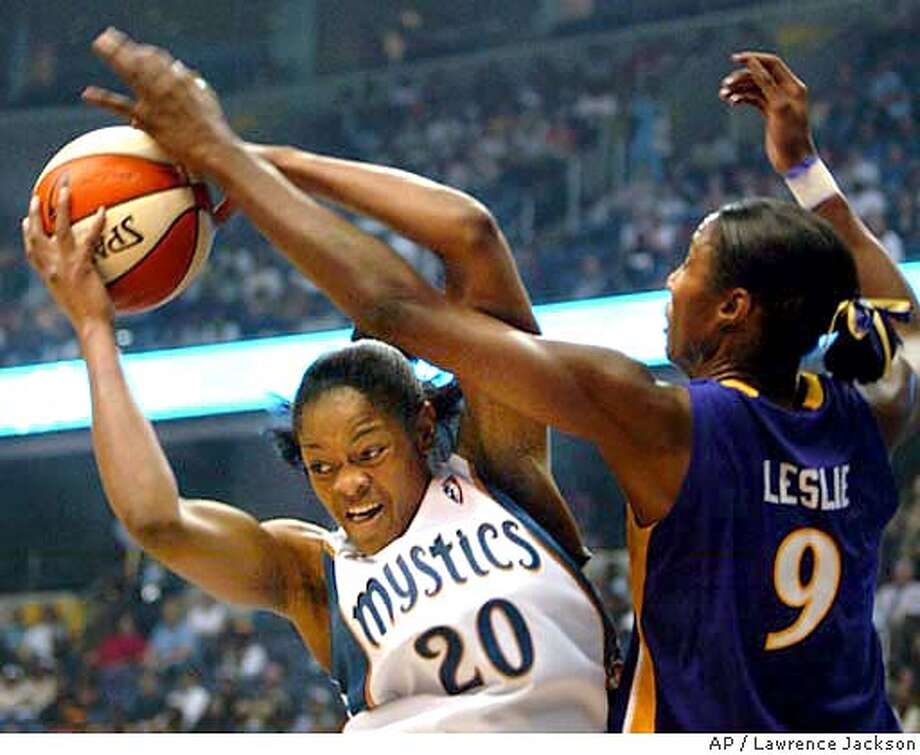 Washington Mystics' Alana Beard (20) grabs a rebound against Los Angeles Sparks' Lisa Leslie (9) in the first half Tuesday, May 25, 2004, in Washington. (AP Photo/Lawrence Jackson) Photo: LAWRENCE JACKSON