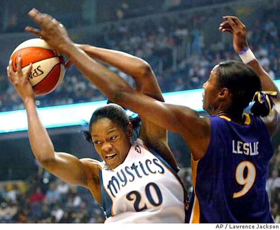 Washington Mystics' Alana Beard (20) grabs a rebound against Los Angeles Sparks' Lisa Leslie (9) in the first half Tuesday, May 25, 2004, in Washington. (AP Photo/Lawrence Jackson) Photo: LAWRENCE JACKSON