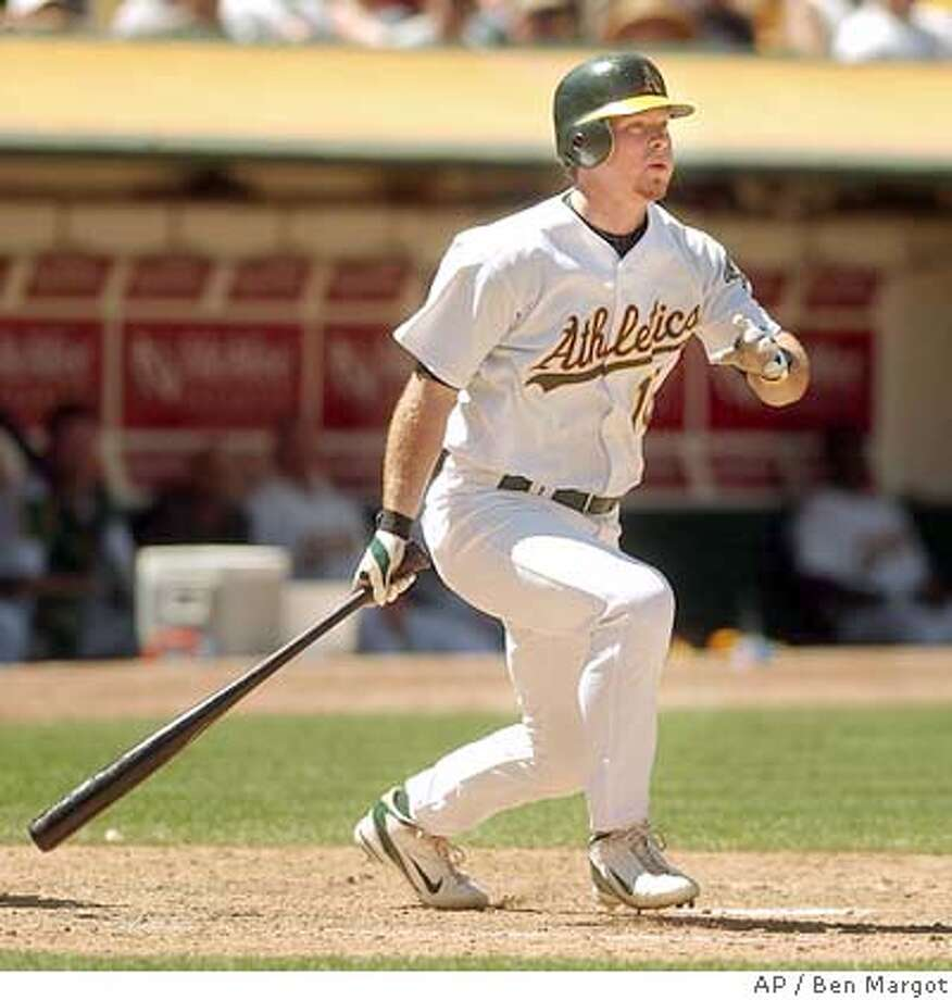 Oakland Athletics' Scott Hatteberg swings for a three-run double off Toronto Blue Jays' Kerry Ligtenberg in the seventh inning Sunday, June 6, 2004, in Oakland, Calif. . (AP Photo/Ben Margot) Photo: BEN MARGOT