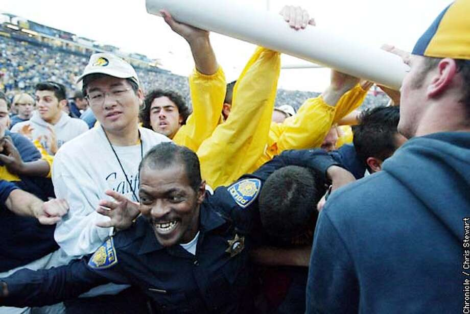 A Scuffle broke out between security and Cal fans after the fans broke down the goal posts following their victory over the Stanford Cardinals in the Big Game at Memorial Stadium on the Cal campus. BY CHRIS STEWART/THE CHRONICLE Photo: CHRIS STEWART