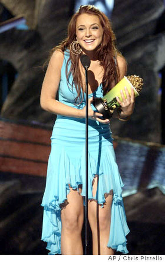 Actress Lindsay Lohan accepts the award for Breakthrough Female during the on Saturday, June 5, 2004, in Culver City, Calif. The show will air on Thursday, June 10. (AP Photo/Chris Pizzello) Photo: CHRIS PIZZELLO