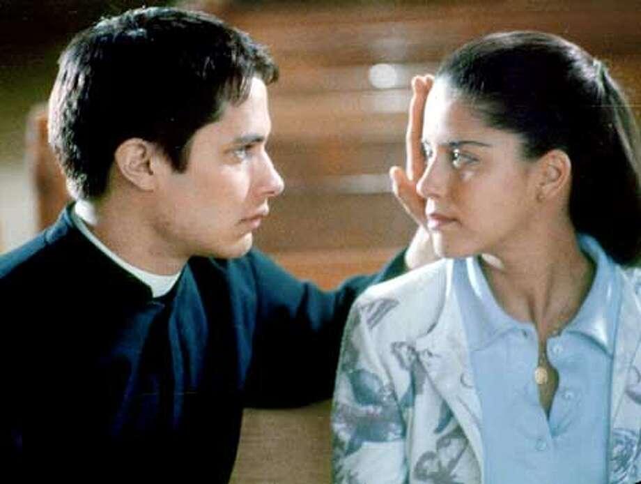 AMARO21C-C-19NOV02-DD-HO --- Gael Garc�a Bernal as Father Amaro and Ana Claudia Talanc�n as Amelia in EL CRIMEN DEL PADRE AMARO.. Photos courtesy of Samuel Goldwyn Films (HANDOUT PHOTO)