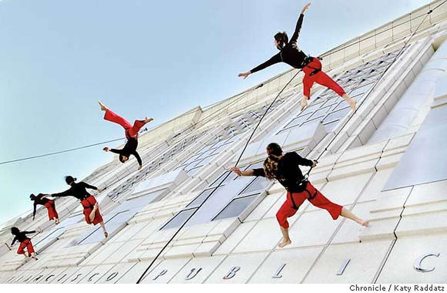 SHOWN: Members of Bandaloop perform their extraordinary dance feats on the front wall of the library to help celebrate. A library is all about freedom of expression. San Francisco Main Library celebrates 125 years of existence. A party! Katy Raddatz / The Chronicle Photo: Katy Raddatz