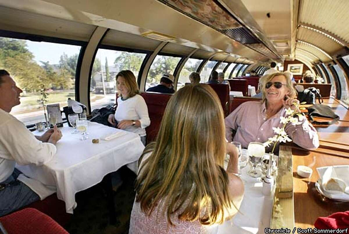While they wait for lunch, passengers relax in the dining car as the train rumbles through Napa. Chronicle photo by Scott Sommerdorf