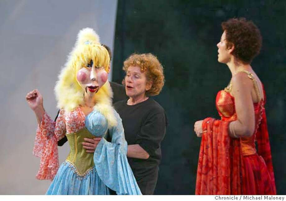 "Joan Mankin (left) operates the puppet with the help of Sam Word (hidden). At right is Stacy Ross.  Photo call for California Shakespeare Theater's opening show, ""The Comedy of Errors"" at Bruns Amphitheater in Orinda. The production is a radical new look at the old play in terms of design and use of puppets. Ron Campbell, Andy Murray, Joan Mankin and Stacy Ross are principal actors. Photo by Michael Maloney / San Francisco Chronicle Photo: Michael Maloney"