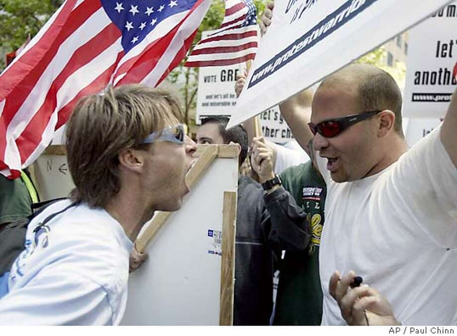 Unidentified protesters square off in a war of words during an anti-war protest in San Francisco on Saturday, June 5, 2004. The rally, organized by International ANSWER (Act Now to Stop War and End Racism) were the largest in the state since protests in March on the one-year anniversary of the start of the war. Five people were arrested, two for blocking traffic, as hundreds marched from City Hall to the waterfront downtown. (AP Photo/San Francisco Chronicle, Paul Chinn) Photo: PAUL CHINN