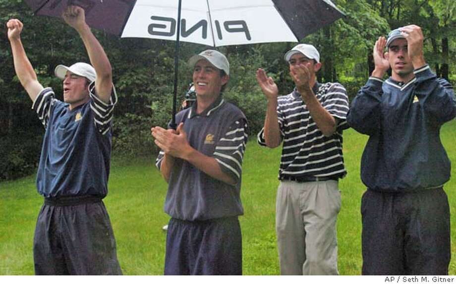 California golfers celebrate after winning the NCAA Division I men's championship Friday, June 4, 2004, in Hot Springs, Va. (AP Photo/The Roanoke Times, Seth M. Gitner) Cal golfers, undaunted by the wet conditions, celebrate beating UCLA by six shots to win the NCAA title in Hot Springs, Va. ProductNameChronicle Photo: SETH M. GITNER
