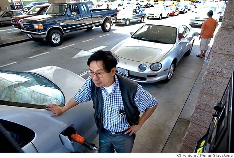 Kevin Cheung a contractor from SF, often fills up here at Costco. Note the lineup of cars behind him,  cheaper gasoline in the Bay Area as prices hover near record highs. Costco store in South San Francisco, where gas prices are about 15 cents a gallon below average. So. SF on 6/2/04 by PENNI GLADSTONE / The Chronicle Photo: PENNI GLADSTONE