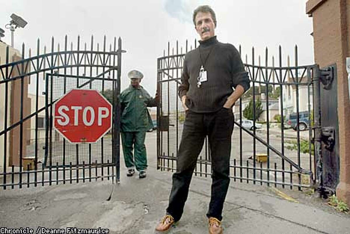Director Joe De Francesca is in front of the East Gate to San Quentin Prison. He directed a production of John Brown's Body inside San Quentin. The guard at the gate is Officer Derry Burney. CHRONICLE PHOTO BY DEANNE FITZMAURICE