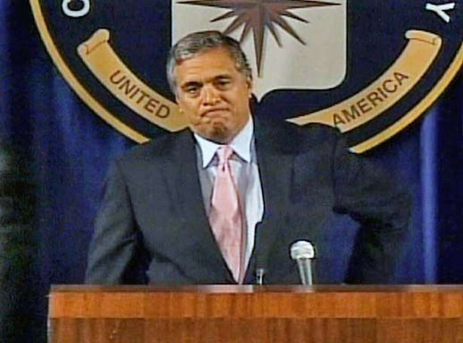 George Tenet lets his emotions show as he announces his resignation as director of the Central Intelligence Agency, effective July 11. Associated Press Television News Image