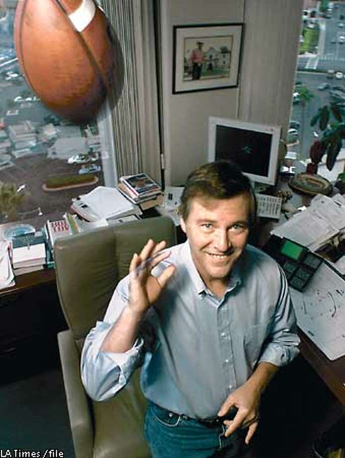 Sports agent Leigh Steinberg, in his Newport Beach office, is suing a former protege, David Dunn, for starting his own sports agency and stealing 57 football players as clients. Photo: Don Tormey