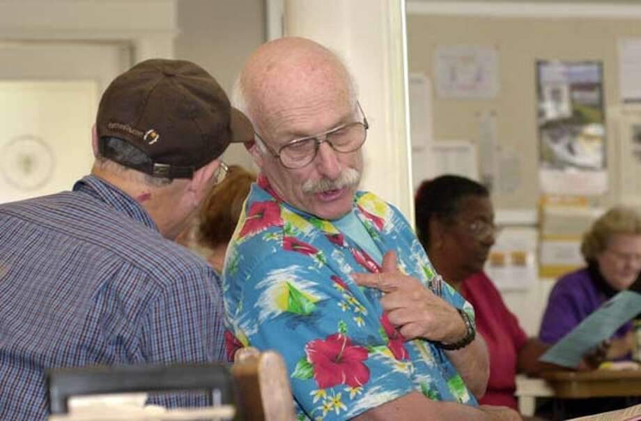 Leonard Brill, 68, right confers with his partner of 32 years, Rik Sanjour, 65, as David Grant of the Senior Action Network meets with a group of seniors at St. Francis Lutheran Church, 152 Church Street for a discussion on the discount drug card June 2, 2004. Photo taken on 06/02/04, in San Francisco, CA.  Photo By ADAM TRAUM / The San Francisco Chronicle Photo: ADAM TRAUM