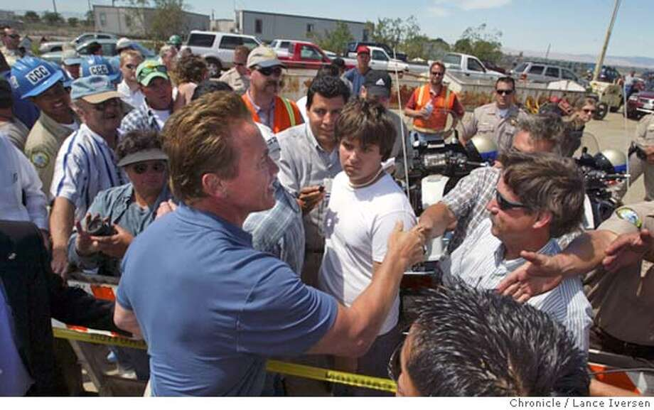 LEVEE070_LI.JPG event on 6/5/04 in STOCKTON Gov Arnold Schwarzenegger talks farmers and residents that have lost crops and homes due to Upper Jones Track levee braking west of Stockton at the Offices of Emergency Services command post adjacent to HW4 at Trapper Road. Over 11,000 acres have been lost to date.  By Lance Iversen/The San Francisco Chronicle Photo: Lance Iversen