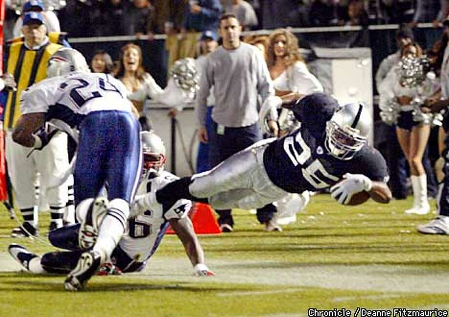 Charlie Garner dives at the 2 yard line for a yardage gain to set up the Crockett TD in 2nd half. Oakland Raiders vs New England Patriots at Network Associates Coliseum on November 17, 2002.  CHRONICLE PHOTO BY DEANNE FITZMAURICE Photo: DEANNE FITZMAURICE