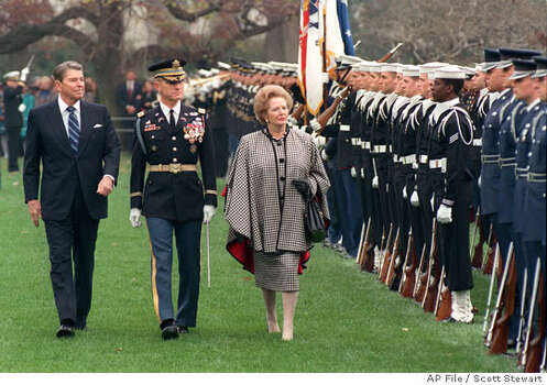 President Reagan reviewed an honor guard with British Prime Minister Margaret Thatcher in 1988. Associated Press file photo by Scott Stewart