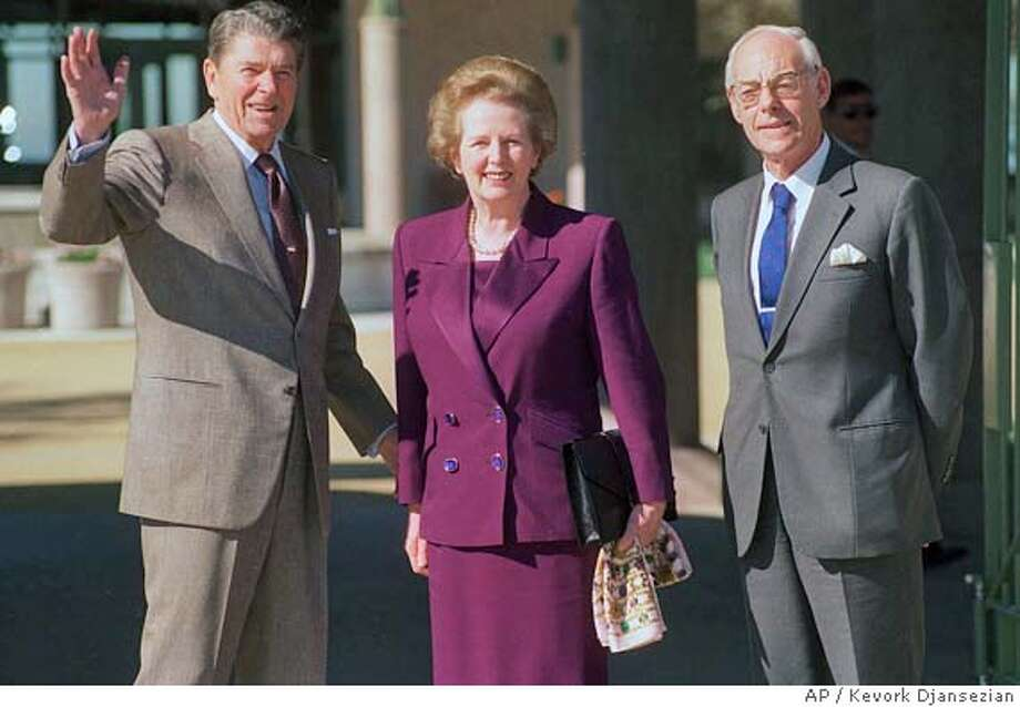 President Ronald Reagan and British Prime Minister Margaret Thatcher tour the Ronald Reagan presidential library in Simi Valley, California, February 4, 1991. Thatcher's husband Denis is at right. (AP Photo/Kevork Djansezian) Photo: KEVORK DJANSEZIAN