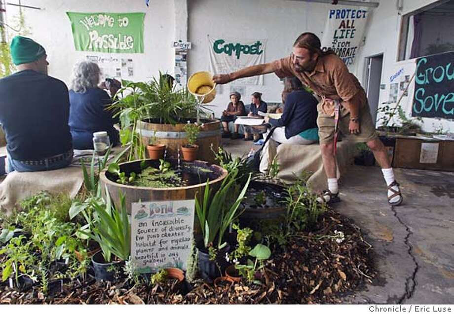 "Erik Ohlsen, Permaculture Activist, put together the ""Garden Lounge"" and will distribute all the plants to urban gardens in San Francsico.  Activist group that beieves in supporting healthy life on earth and will be apposing the biotech confrence. Reclaim the Commons Welcome Center on Howard in San Francisco. Event on 6/4/04 in San Francisco. Eric Luse / The Chronicle Photo: Eric Luse"