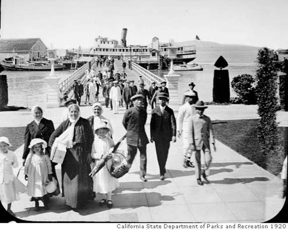 Immigrants arriving at Angel Island c.1920. Credit: California State Department of Parks and Recreation. Immigrants land at Angel Island about 1920. Some Chinese were detained on the island for weeks, months or sometimes years.