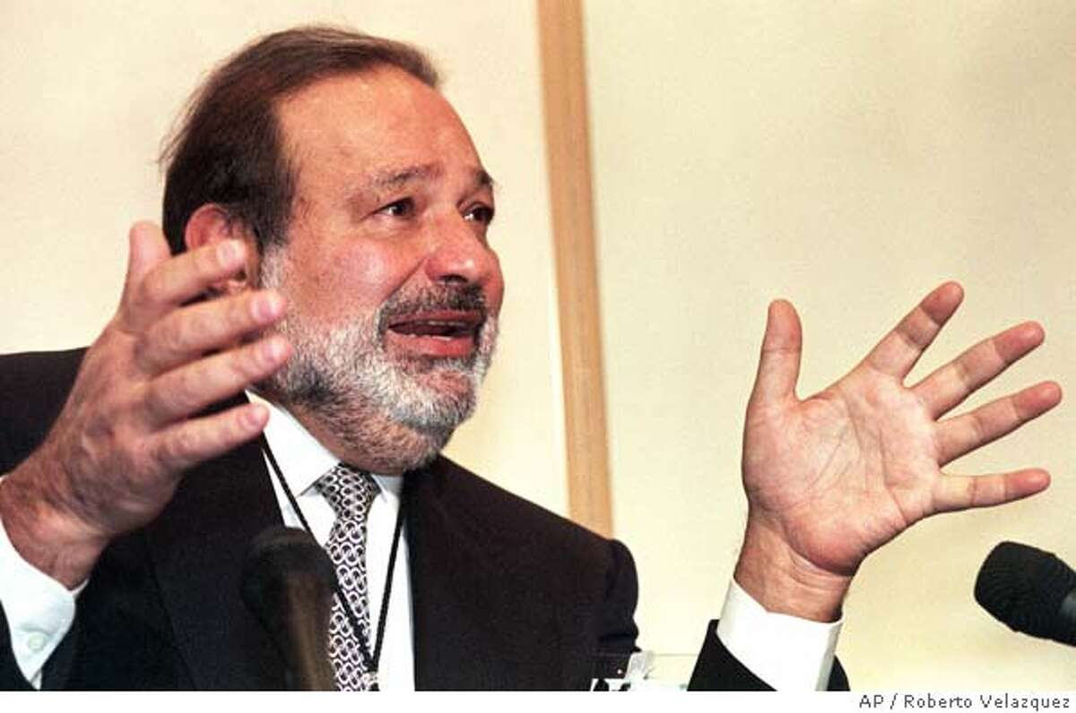 FILE--Carlos Slim Helu is seen in this file picture during an interview on in Mexico City. Slim Helu, by some accounts the richest man in Latin America, has been spending a lot of his time lately in a tiny Dallas courtroom, where he is on trial in a case that's either about greed and betrayal or about business incompetence. It depends on who you believe. (AP Photo/Roberto Velazquez)