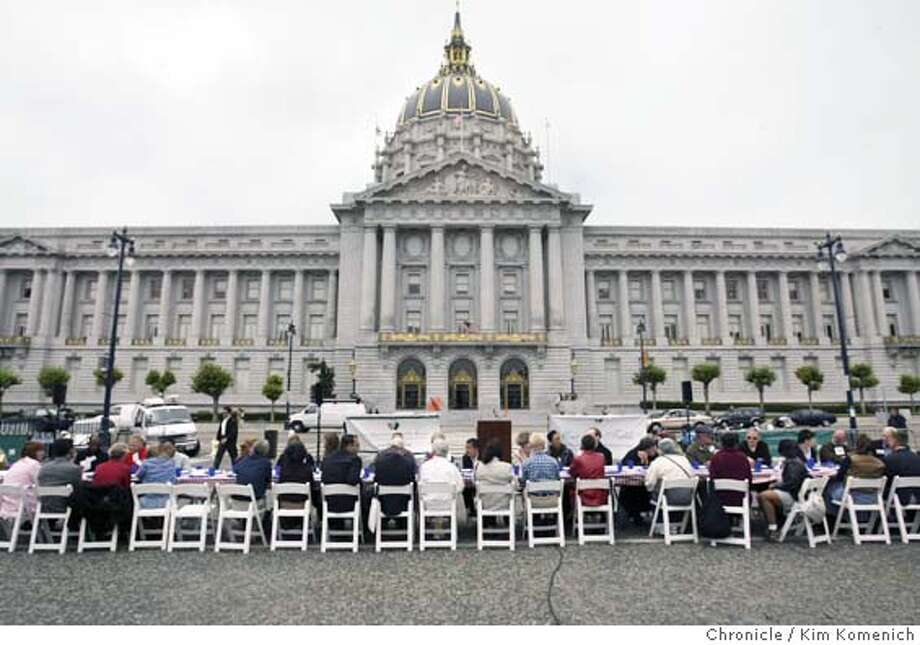 "On National Hunger Awareness Day, ""One Big Table"" brings together activists and interested parties who sit at a huge lunch table in Civice Center Plaza and are NOT served food. They talk about hunger issues instead. Photo by Kim Komenich in San Francisco. Photo: Kim Komenich"