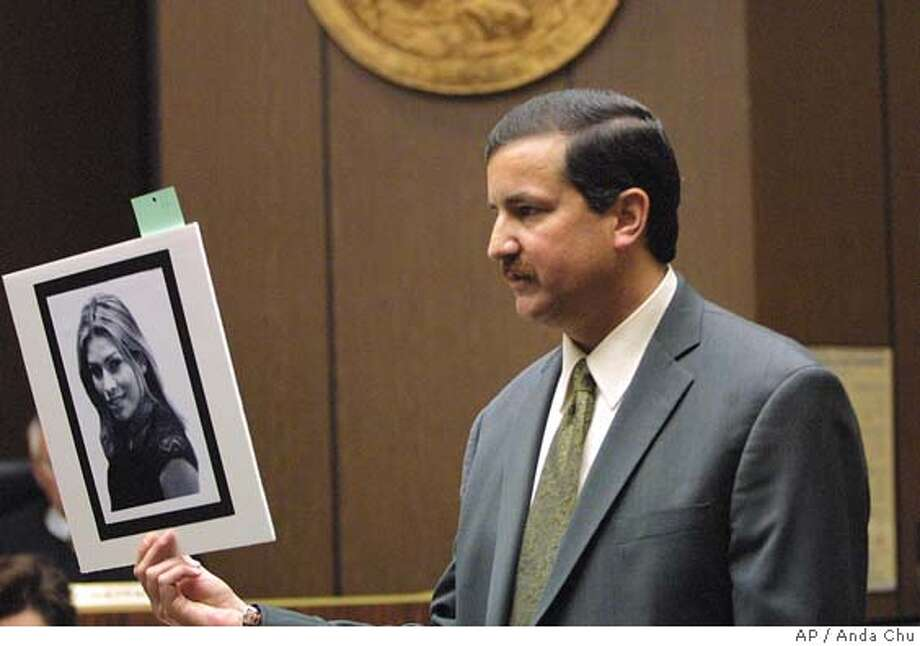 "Alameda County District Attorney Chris Lamiero shows a picture of Eddie ""Gwen"" Araujo to the jury during his open statements Wednesday, April 14, 2004, in Hayward, Calif., in the trial of the three men charged in Aruajo's death. The killing of Araujo, a transgender teen, was cold-blooded murder carried out by three men furious they had been deceived by a beautiful girl who turned out to be biologically male, the prosecutor said as he began presenting his case Wednesday. (AP Photo/Fremont Argus, Anda Chu) Alameda County District Attorney Chris Lamiero holds a picture of Gwen Araujo during his opening statement in April. Photo: ANDA CHU"