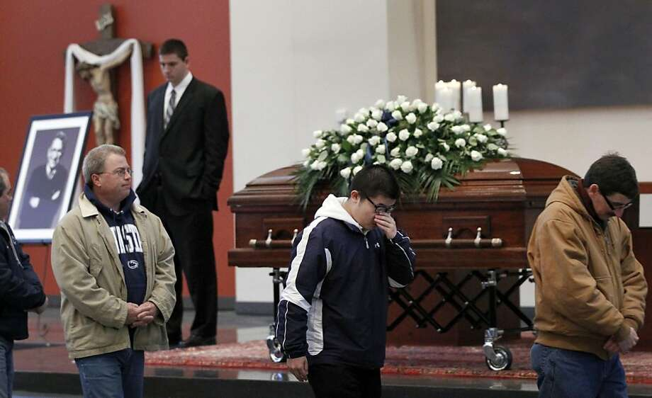 Mourners file through the Pasquerilla Spiritual Center on the Penn State campus during the viewing session for former Penn State football coach Joe Paterno on Tuesday, Jan. 24, 2012 in State College, Pa. Paterno died Sunday morning. (AP Photo/Alex Brandon) Photo: Alex Brandon, Associated Press