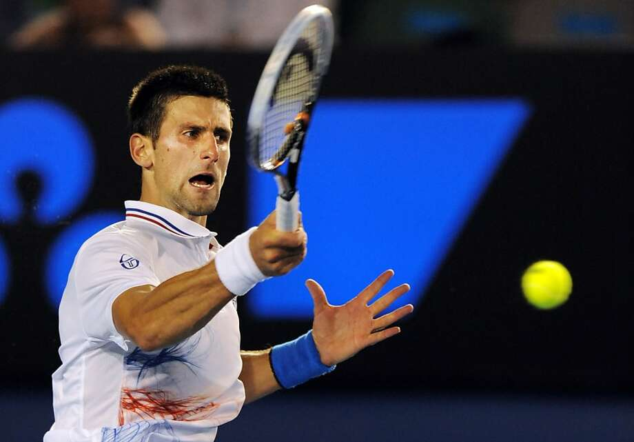 Novak Djokovic of Serbia hits a shot against David Ferrer of Spain in their men's singles quarter-final match on day ten of the 2012 Australian Open tennis tournament in Melbourne on January 25, 2012. Photo: Greg Wood, AFP/Getty Images