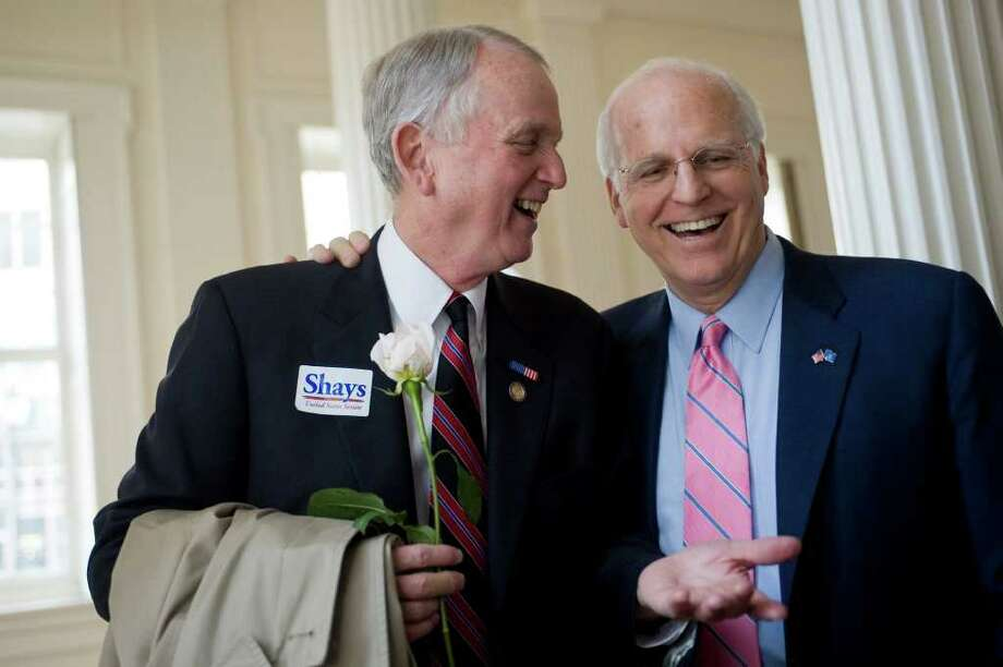Former Connecticut U.S. Rep. Christopher Shays, right, shares a light moment with former U.S. Rep. Rob Simmons after Shays formally announced he is running as a Republican candidate for U.S. Senate at the Old State House in Hartford, Conn., Wednesday, Jan. 25, 2012.  Shays joins four others seeking the GOP nomination.  (AP Photo/Jessica Hill) Photo: Jessica Hill, Associated Press / AP2012