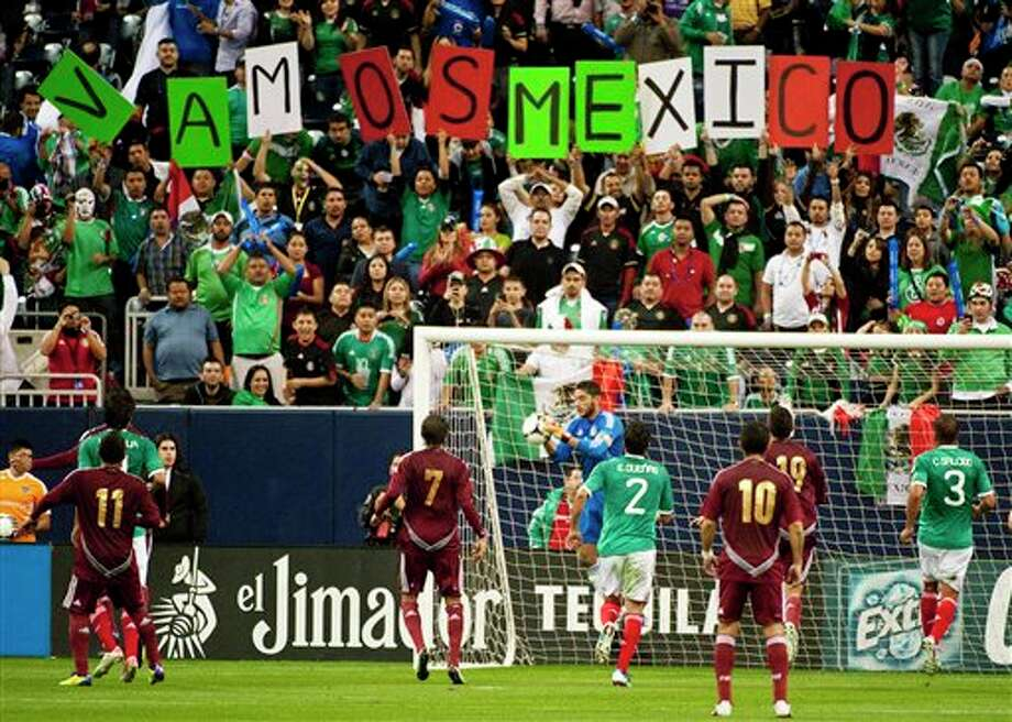 Mexico goalie Leonardo Morales, center, saves a shot during the first half of a friendly soccer match against Venezuela, Wednesday, Jan. 25, 2012, in Houston. (AP Photo/Dave Einsel) Photo: Dave Einsel, Associated Press / FR43584 AP
