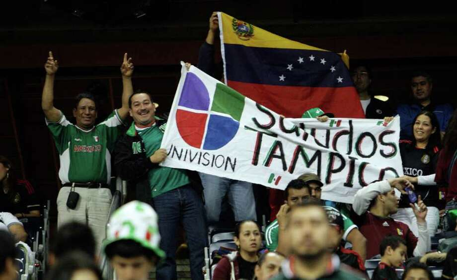 HOUSTON - JANUARY 25:  Fans cheer on their teams during the international friendly between Mexico and Venezuela at Reliant Stadium on January 25, 2012 in Houston, Texas. Mexico defeated Venezuela 3-1. Photo: Bob Levey, Getty Images / 2012 Getty Images