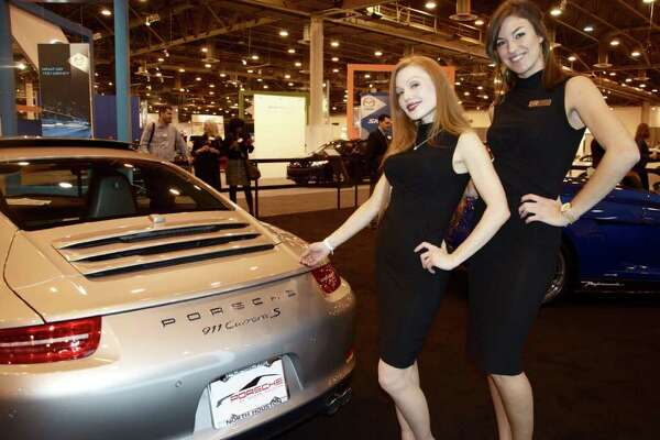Models at the Houston Auto Show show off the vehicles on display.