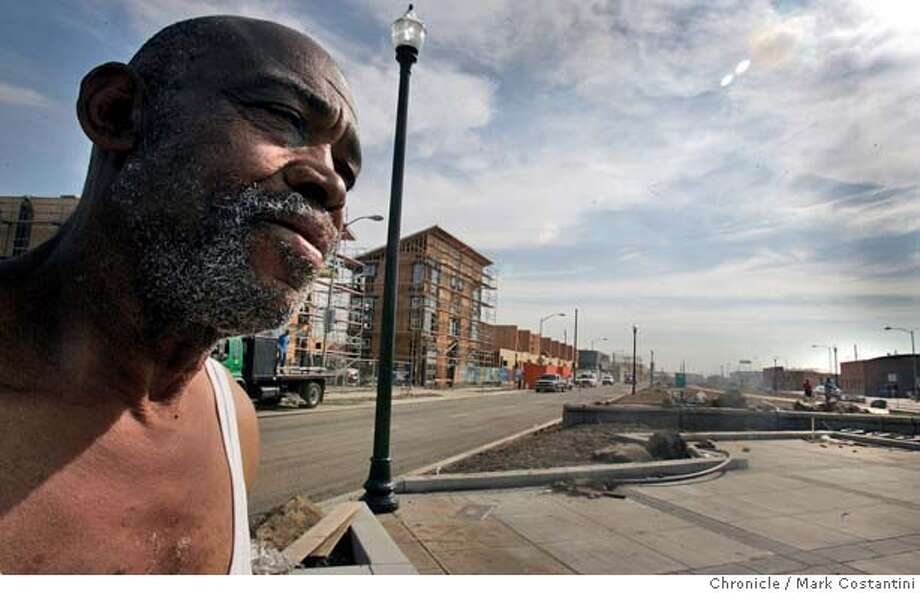 Thomas Summerville, 63, reflects on the earthquake. He's on Mandela Parkway. Behind him is the West End Commons housing development, which is under construction.  For story on the impact of the earthquake, 15 years later, in the area around Mandela Parkeway, the location of the former Cypress Structure  Event on 10/15/04 in Oakland. S.F. Chronicle photo by Mark Costantini. Metro#Metro#Chronicle#10/17/2004#ALL#5star##0422415497 Photo: Mark Costantini