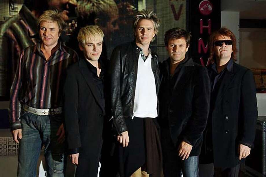 "From left: Simon LeBon, Nick Rhodes, John Taylor, Roger Taylor, and Andy Taylor from pop group Duran Duran pose for photographers during an in-store appearance at HMV Records store on Oxford Street in central London, Monday, Oct. 4, 2004, to sign copies of their latest single '""(Reach Up For The) Sunrise.""(AP Photo/PA, Yui Mok) ** UNITED KINGDOM OUT MAGS OUT ** UNITED KINGDOM OUT MAGS OUT Datebook#Datebook#SundayDateBook#10-17-2004#ALL#Advance##0422393867 Photo: YUI MOK"