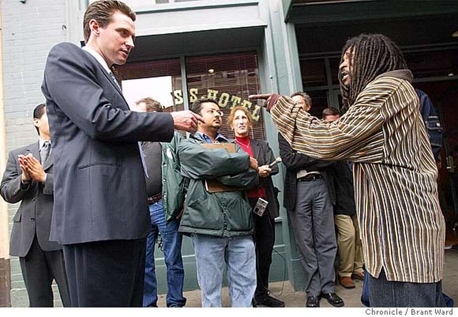 outreach075.jpg  Outside the Empress Hotel on Eddy Street, Mayor Newsom and homeless person Frank Johnson got into a discussion about personal records being kept for the hotel tenants under Care Not Cash programs. Mayor Gavin Newsom spent Wednesday morning walking around the Tenderloin and Civic Center areas with his new outreach workers talking with homeless. He also piloted a street cleaner and rode it back to City Hall BRANT WARD / The Chronicle MANDATORY CREDIT FOR PHOTOG AND SF CHRONICLE/ -MAGS OUT Insight#Insight#Chronicle#10/17/2004##Advance##0422234917 Photo: BRANT WARD