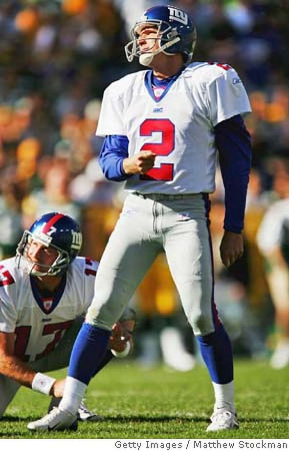 GREEN BAY, WI - OCTOBER 3: Place kicker Steve Christie #2 and Jeff Feagles #17 of New York Giants watch as his third field goal attempt misses in the fourth quarter against the Green Bay packers October 3, 2004 at Lambeau Field in Green Bay, Wisconsin. (Photo by Matthew Stockman/Getty Images) *** Local Caption *** Steve Christie;Jeff Feagles Sports#Sports#Chronicle#10/17/2004#ALL#2star##0422392287 Photo: Matthew Stockman