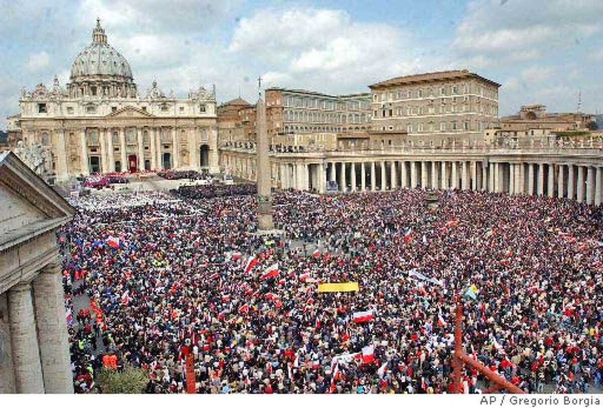 Crowds pack St.Peter's Square at the Vatican, Friday April 8, 2005, at the start of the funeral of Pope John Paul II. Royalty, political power brokers and multitudes of the faithful will pay their last respects to Pope at a funeral promising to be one of the largest Western religious gatherings of modern times. AP Photo/Gregorio Borgia