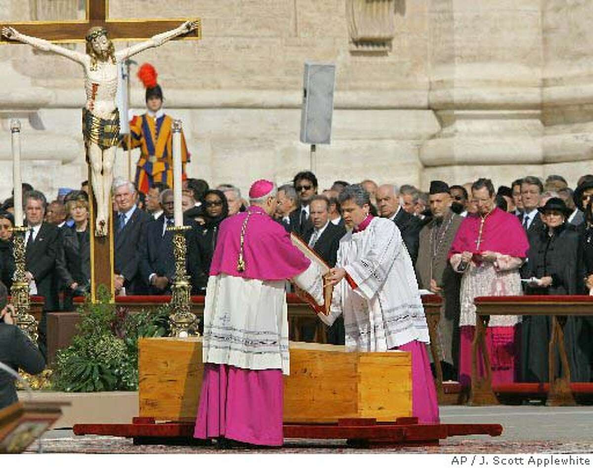 The wooden casket bearing the remains of Pope John Paul II is prepared for the funeral Mass in St. Peter's Square at the Vatican, Friday, April 8, 2005, in Vatican City. Presidents, prime ministers and kings joined pilgrims and prelates in St. Peter's Square on Friday to bid farewell to Pope John Paul II at a funeral service that drew millions to Rome for one of the largest religious gatherings of modern times. AP Photo J. Scott Applewhite