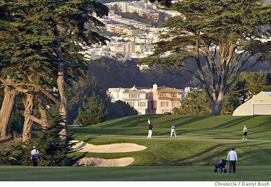 Golfers on the 18th hole at Harding Park Golf Course. 10/11/04 in San Francisco  Darryl Bush / The Chronicle Photo: Darryl Bush