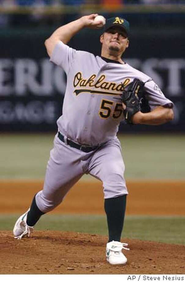 Oakland Athletics starter Joe Blanton pitches against the Tampa Bay Devil Rays during the first inning Friday, April 8, 2005 at Tropicana Field in St. Petersburg, Fla. (AP Photo/Steve Nesius) Photo: STEVE NESIUS