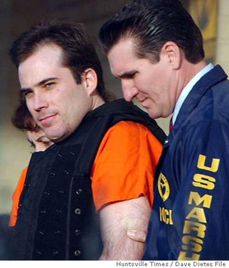 ** FILE * is led from federal courthouse in Huntsville, Ala., March 29, 2005, following a court appearance. Rudolph has agreed to plead guilty to the 1996 bombing at the Atlanta Olympics and three other blasts, a source close to the case told The Associated Press on Friday, April 8, 2005. (AP Photo/Huntsville Times, Dave Dieter) Photo: DAVE DIETER