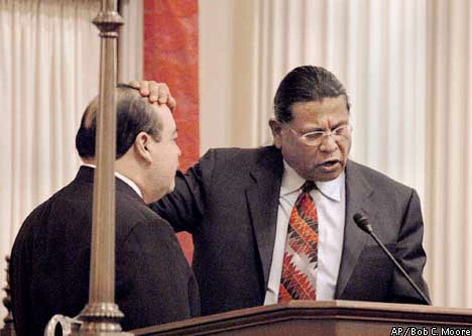 Anthony Pico, right, tribal chair of the Viejas Band of Kumeyaay Indians, gives a Native American blessing to California Lt. Governor Cruz M. Bustamante during Bustamante's swearing-in ceremony Monday, Jan. 6, 2003, at the Capitol in Sacramento, Calif. (AP Photo/Bob C. Moore) Photo: BOB C. MOORE